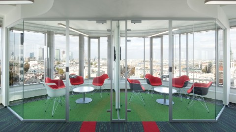 Picture 3: Colorful sitting area within an office in Warsaw's Zebra Tower.