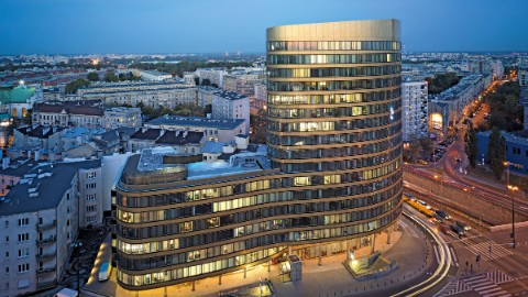 Picture 1: Warsaw office building Zebra Tower against night sky.