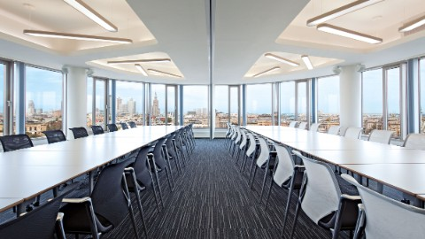 Picture 5: Long rows of tables in an office space at Warsaw's Zebra Tower.