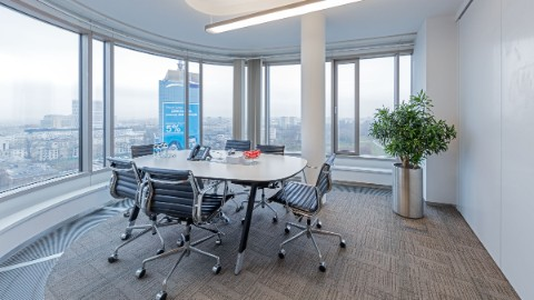 Picture 2: Meeting area within an office at Zebra Tower with view on Warsaw.