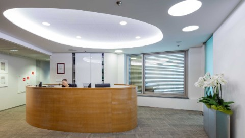 Picture 5: Reception desk and welcome area within an office space of Warsaw's Zebra Tower.